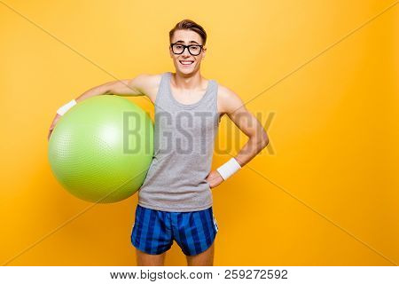 Ready For Training! Portrait Of Careless, Carefree Man Holds A Big Green Ball At Hand, Make Good Bea
