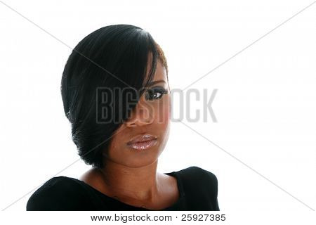 A beautiful African American adult woman models a hair style isolated on white