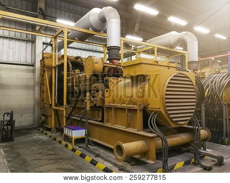 A Very Large Electric Diesel Generator In Factory For Emergency,equipment Plant Modern Technology In