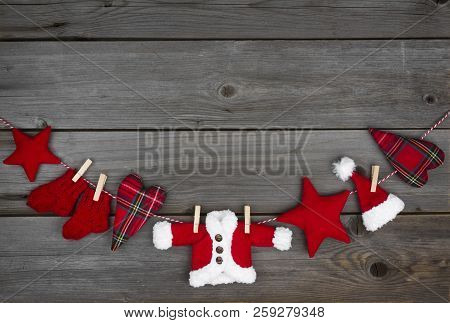 Christmas Concept With Garland Of Decorations On Vintage Wooden Background