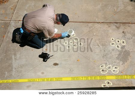 a crime scene detective investigates and gathers evidence at a drive by shooting crime scene.