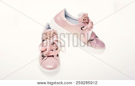 Glamorous Sneakers Concept. Footwear For Girls And Women Decorated With Pearl Beads. Pair Of Pale Pi
