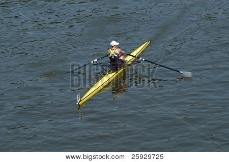 Athlete rowing ahead during a boat-race on the River Vltava in Prague, Czech Republic.