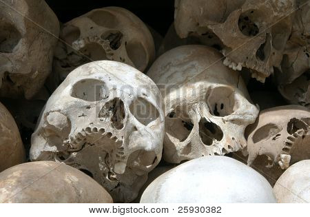 Skulls from a mass grave of Khmer Rouge victims in Choeung Ek aka the Killing Fields near Phnom Penh, Cambodia. poster