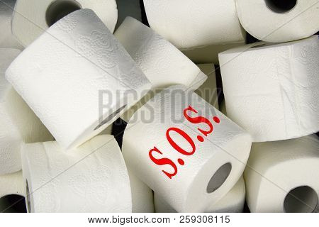 Many Rolls Of White Toilet Paper. A Matter Of Daily Necessity With Inscription S.o.s.detail Of Toile