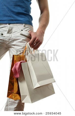 Young sexy man with shopping bags isolated on white