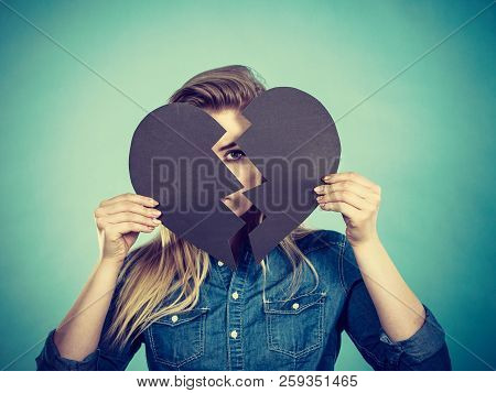 Sad Young Teenage Woman With Broken Heart Made Of Paper. Negative Sad Emotions, Relationship Problem