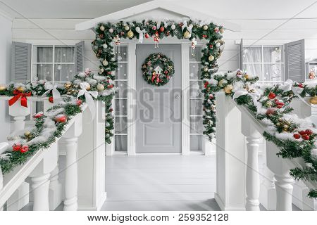 Christmas Morning. House Entrance Decorated For Holidays. Christmas Decoration. Garland Of Fir Tree