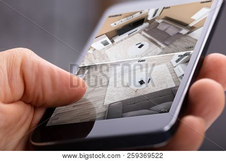 Person Using Home Security System