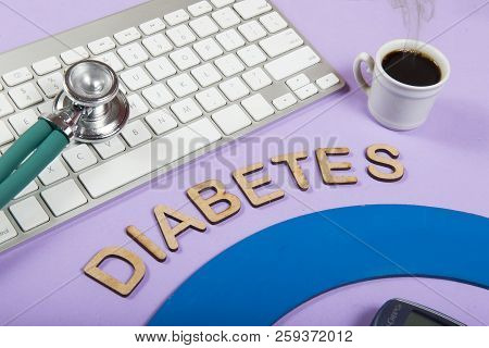 Keyboard And Stethoscope On Lilac Background, With The Word Diabetes