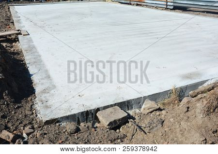 Slab-on-grade Foundation On House Construction Site. Monolithic Slabs Are Foundation Systems Constru