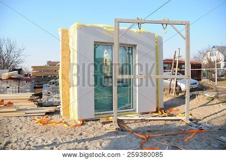 Modular frame plywood board panel walls house on the home construction site. Structural insulated panels house installation. poster