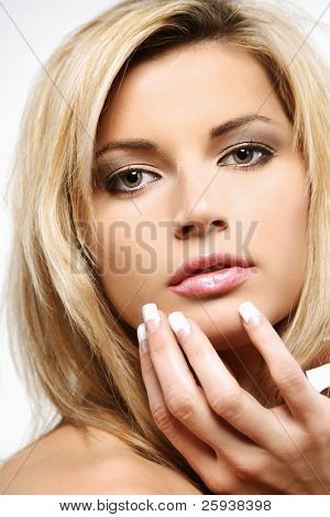 Attractive blond girl with long hair on white background.