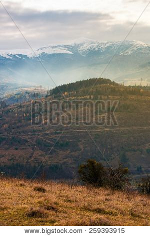 Gloomy November Scenery In Mountains. Foggy And Hazy Forenoon On An Overcast Day. Distant Mountain T