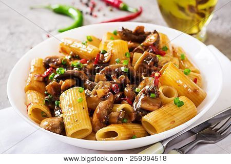 Vegetarian Pasta  Rigatoni With Mushrooms And Chilli Peppers In White Bowl On Grey Table. Vegan Food