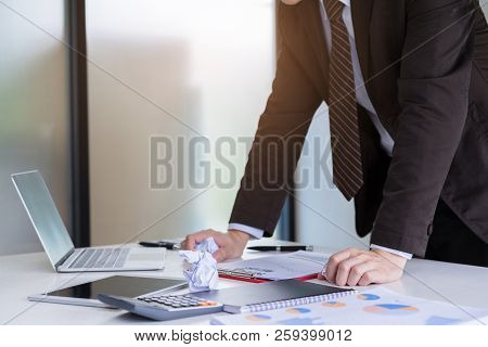 Unhappy Young Businessman Hand Holding A Crumpled Paper. Negative Human Emotion Facial Expression Fe