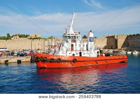 RHODES, GREECE - JUNE 12, 2018: Heracles Star tugboat moored at Kolona port in Rhodes Old Town on the Greek island of Rhodes. The 31mtr vessel was built in 2002 in Greece.