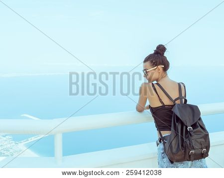 Fashion Young Girl With Backpack In Casual Clothes Glasses Enjoying A View From The Mountain To The