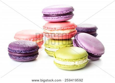 Heap Of French Macaroons Isolated On White Background