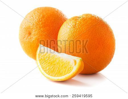 Two Oranges And The Slice Of Orange Isolated On White Background