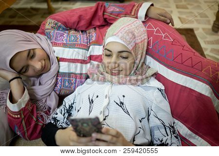 Arabic girls at home with smartphone