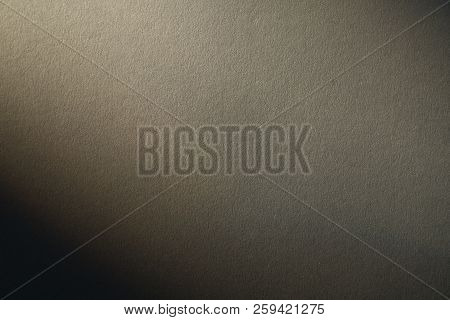 Light Gradient On A Grey Cardboard Background