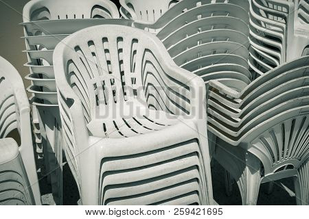 Dirty Old Stacks Of Plastic Chairs Outdoors