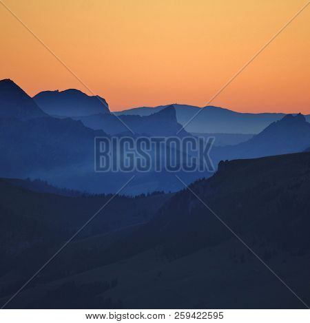 Outlines Of Mount Wiriehore And Other Mountains In The Bernese Oberland. Sunset Seen From Mount Nies