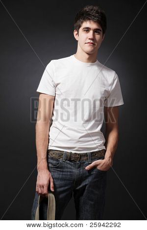 Young attractive happy man wearing white T-shirt.