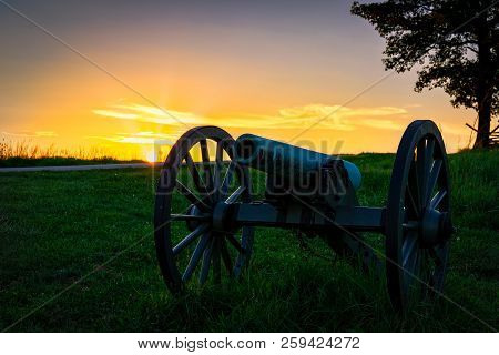 An American Civil War Cannon Sits In A Pennsylvania Field Behind A Wall.