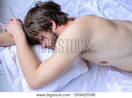 Let Your Body Feel Comfortable. Guy Nude Macho Lay White Bedclothes. Man Sleepy Drowsy Unshaven Bear