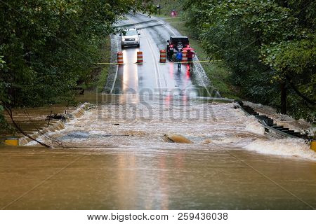 Waxhaw, North Carolina - September 16, 2018: Motorists Inspect A Road Flooded By Rain From Hurricane