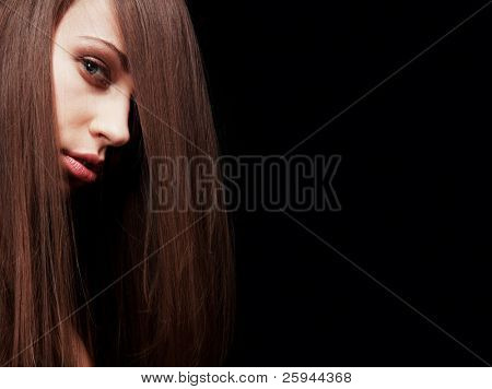 Young beautiful woman with long straight hair.