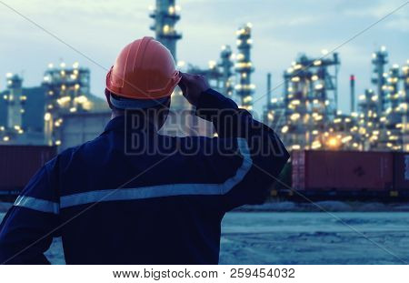 Engineer Is Standing On Large Industry Background.