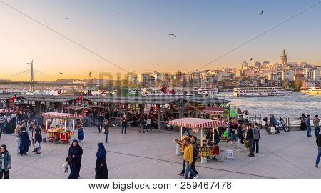 Istanbul, Turkey - April 25, 2017: Eminonu Piazza Before Sunset With Local Citizens Buying Food From