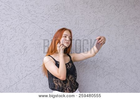 Waist-up Portrait Of Young Red Hair Good-looking Model Taking Selfie Wearing Nice Lace Shirt And Sta