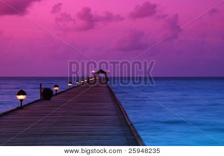 Beautiful sunrise over the sea and jetty in the Maldives, Indian Ocean