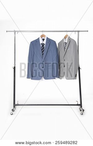 Set of men's suits,ties on hanger-white background