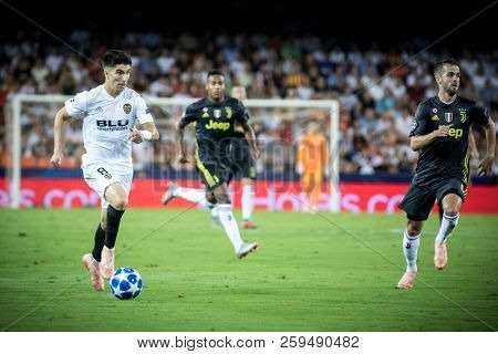 VALENCIA, SPAIN - SETEMBER 19: Carlos Soler with ball during UEFA Champions League match between Valencia CF and Juventus at Mestalla Stadium on September 19, 2018 in Valencia, Spain