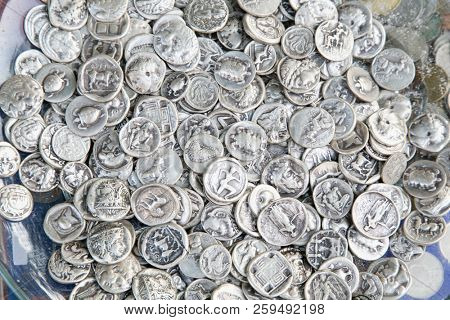 ATHENS GREECE - JUNE 20, 2016: Pile of old coins mostly greek drachma lepta and dekares. Antique money background. Athens, Greece.
