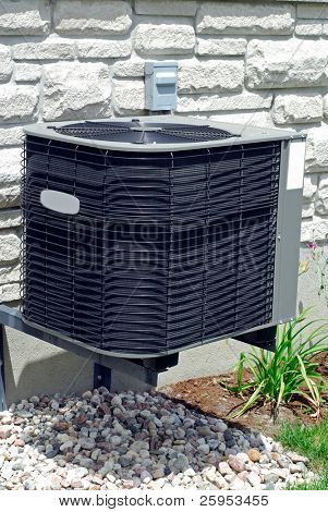 House Air Conditioning Unit Outside A Home