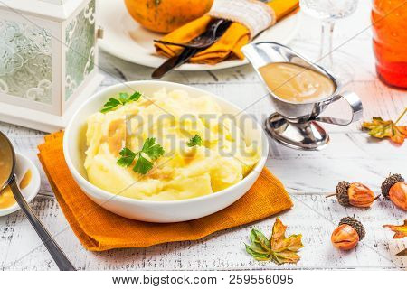 Mashed Potatoes With Gravy Sauce And Parsley - Traditional Side Dish For Thanksgiving Day