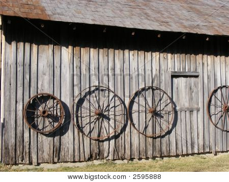 Wagon Wheels on an Old Barn