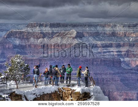 Grand Canyon National Park, Arizona, May 6 2016: Tourists View The Grand Canyon From The Mather Poin