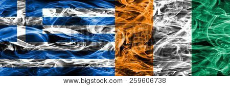 Greece Vs Ivory Coast Smoke Flags Placed Side By Side. Thick Colored Silky Smoke Flags Of Greek And
