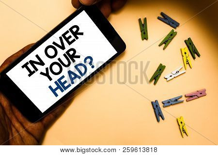 Conceptual Hand Writing Showing In Over Your Head Question. Business Photo Text To Be Involved In A