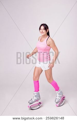 Beautiful Athletic Woman Wearing In Sports Style Clothing With Kangoo Jumps Boots On Her Legs Makes