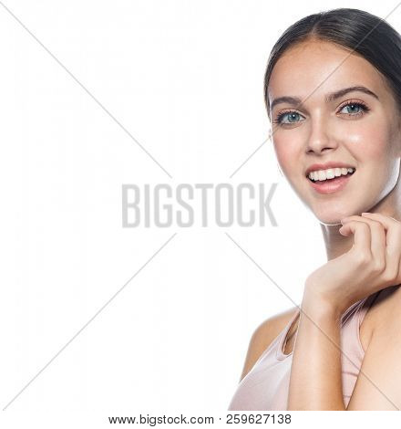 closeup portrait of attractive caucasian smiling woman brunette isolated on white studio shot lips toothy smile face head and shoulders looking at camera teeth