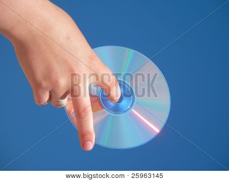 Compact Disk in hand on blue sky