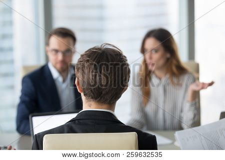 Back View Of Male Ceo Negotiating With Diverse Partners